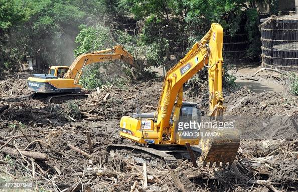 Excavators work at a flooded zoo in the Georgian capital Tbilisi on June 16 2015 AFP PHOTO / VANO SHLAMOV