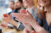 Photo of business people hands applauding at conference