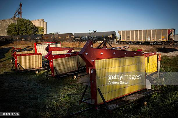 Excess advertising signs are left in a field next to a passing oil train on October 11 2014 in Lincoln Nebraska