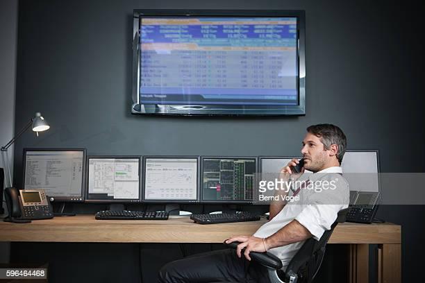 Exchange broker speaking on phone