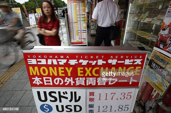 Exchange rates are displayed outside a currency exchange store in Tokyo Japan on Tuesday Aug 25 2015 The yen fell against the dollar for the first...