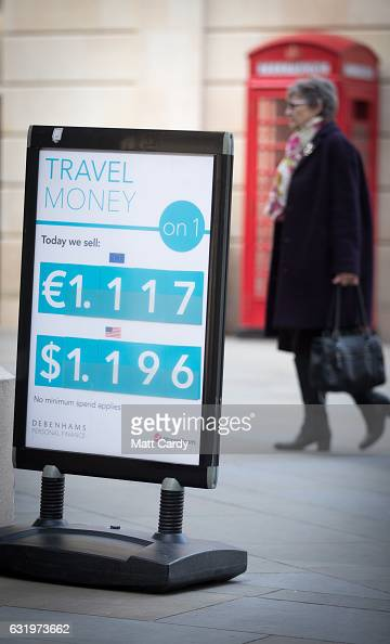 Exchange rates for Dollars and Euros are displayed outside a shop on January 18 2017 in Bath England Sterling has dropped sharply following British...