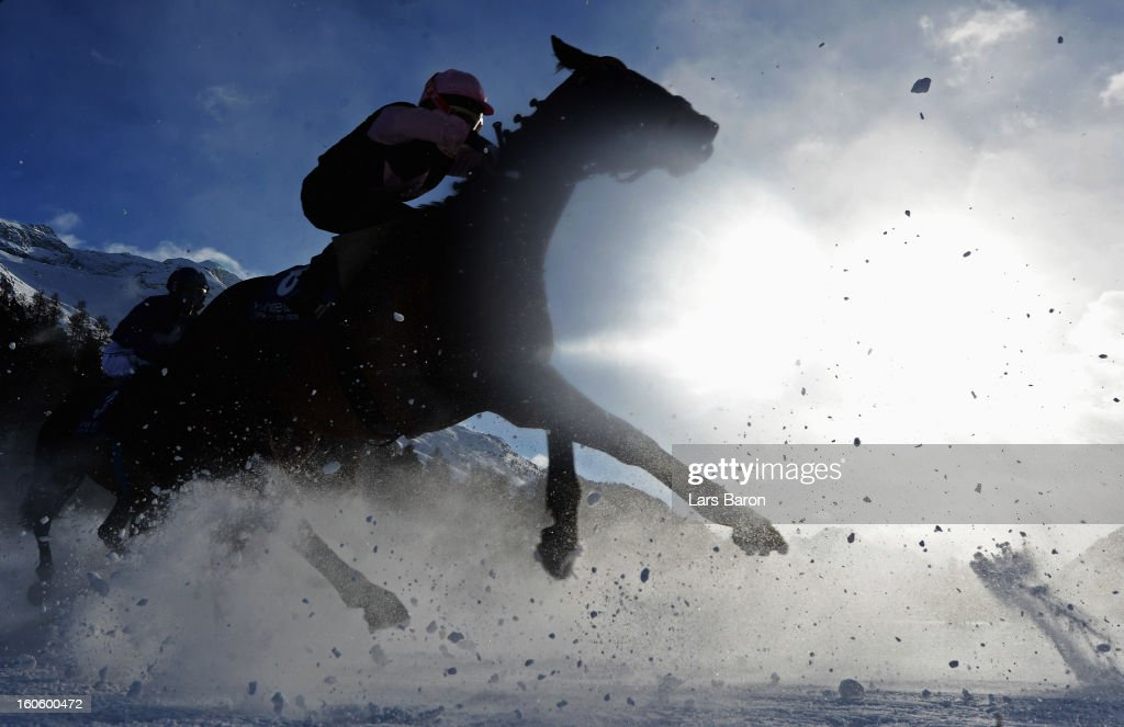 Exchange ridden by Andrea Atzeni compete during the Grand Prix Guardaval Immobilien race at the White Turf horse racing meeting held on the frozen Lake St Moritz on February 3, 2013 in St Moritz, Switzerland.