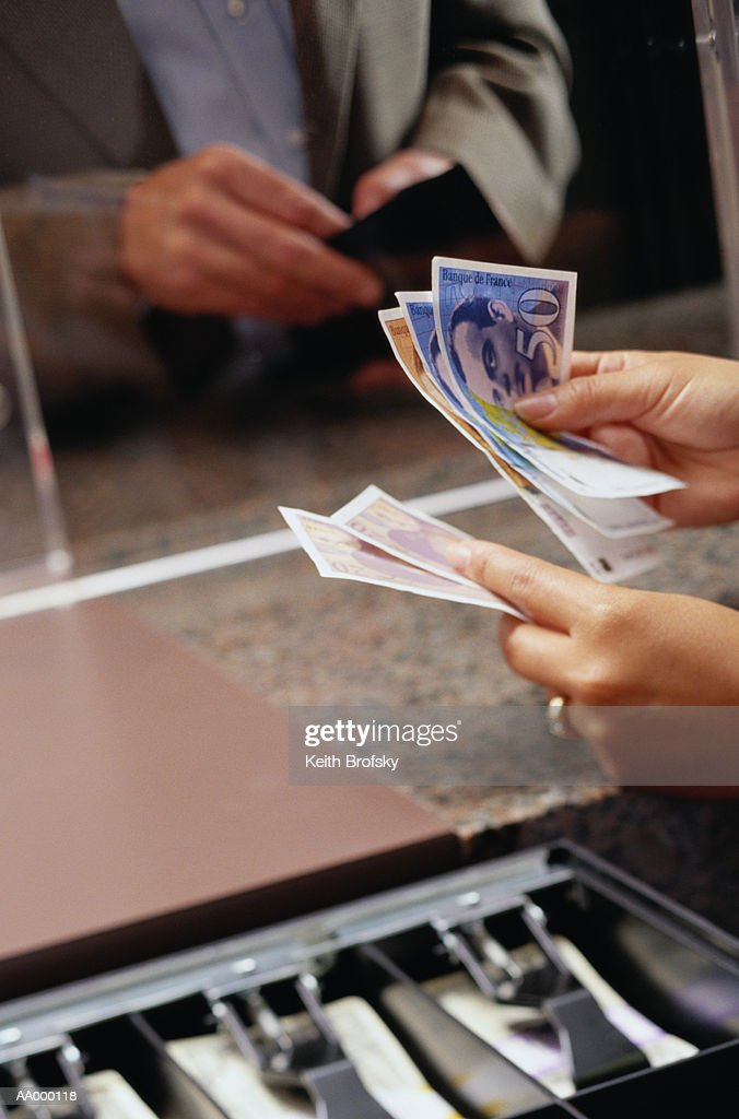 Exchanging Money at the Currency Exchange