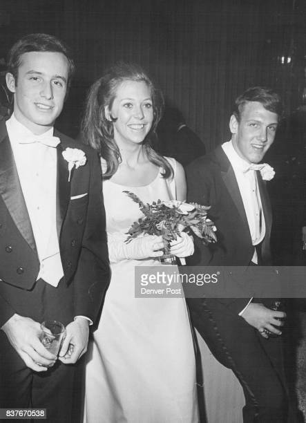 Exchanging party talk at the deb ball are 1967 debuntante Miss Kathleen Ross Ricketson and escorts Peter Bower left and Scott Barrett Two escorts...