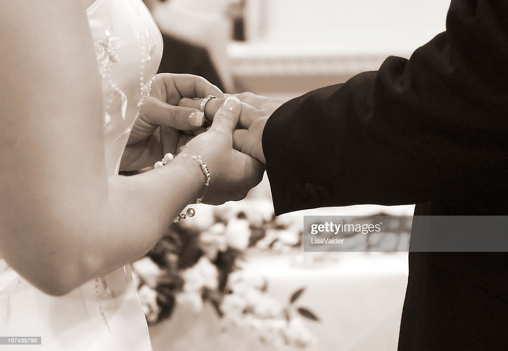 exchanging rings at wedding stock photo getty images