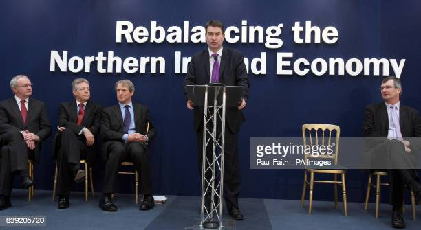 Exchequer Secretary to the Treasury David Gauke speaking in Lisburn Co Antrim as Deputy First Minister Martin McGuinnes First Minister Peter Robinson...