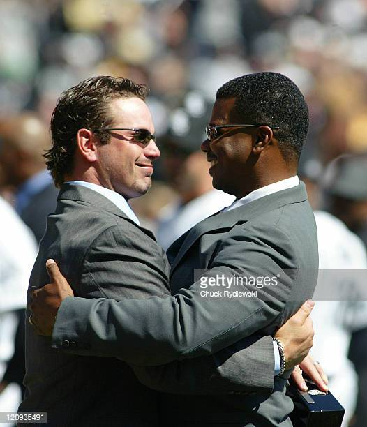 ExChicago White Sox center fielder Aaron Rowand left gets a hug from General Manager Ken Williams after receiving his World Championship ring prior...