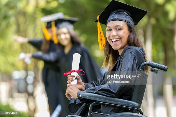 Excited African American college graduate