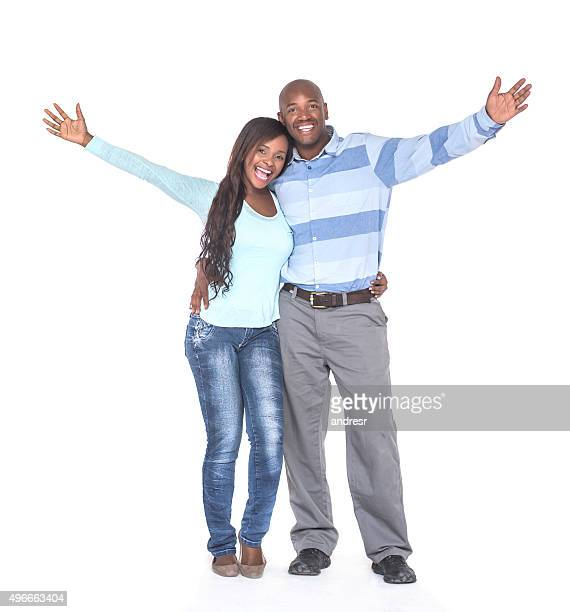 Excited African American couple with arms up