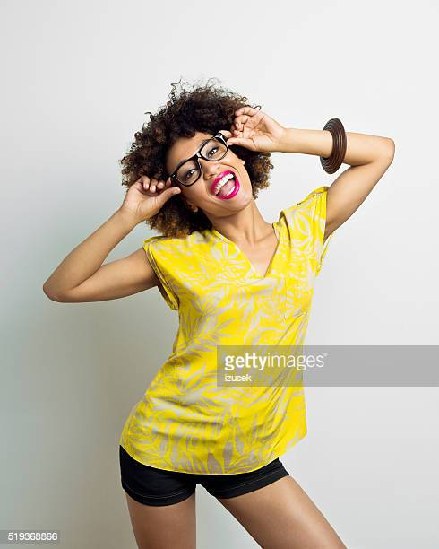 Excited afro american young woman wearing nerd glasses