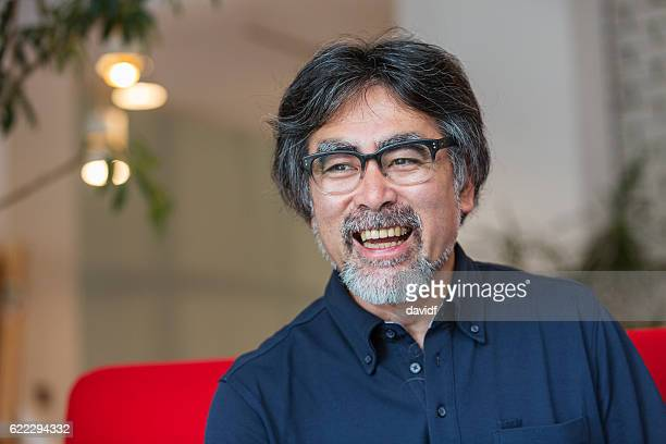 Excited and Happy Senior Japanese Man Relaxing at Home