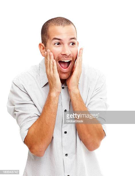 Excited and surprised young man on white