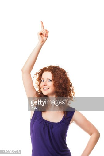 Excited beautiful woman pointing up : Stock Photo