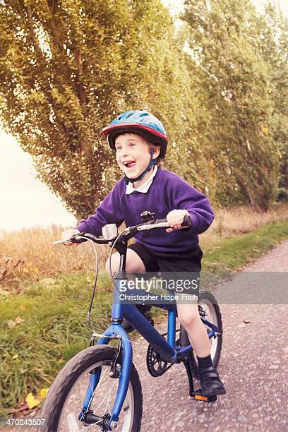 Excited boy cycling home