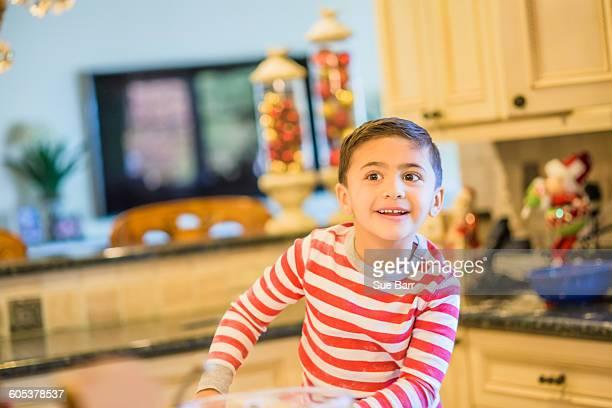 Excited boy in kitchen