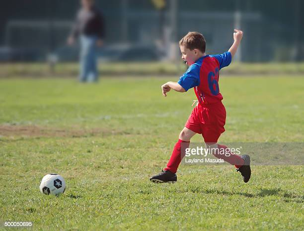 Excited Boy Playing Soccer