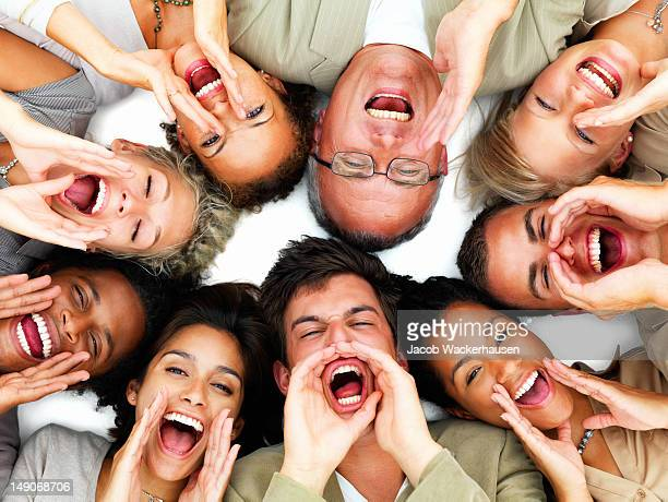 Excited business colleagues lying together on white