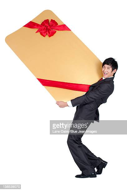 Excited Businessman Holding an Oversized Wrapped Card