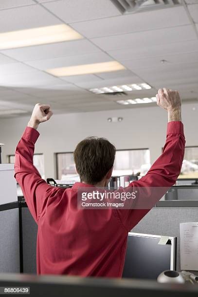 Excited businessman in cubicle