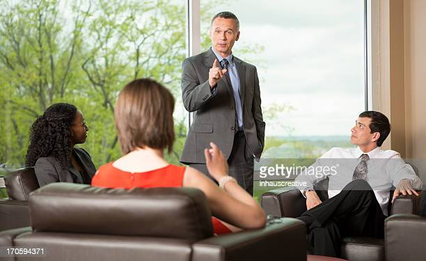 Excited Businessman leading a meeting