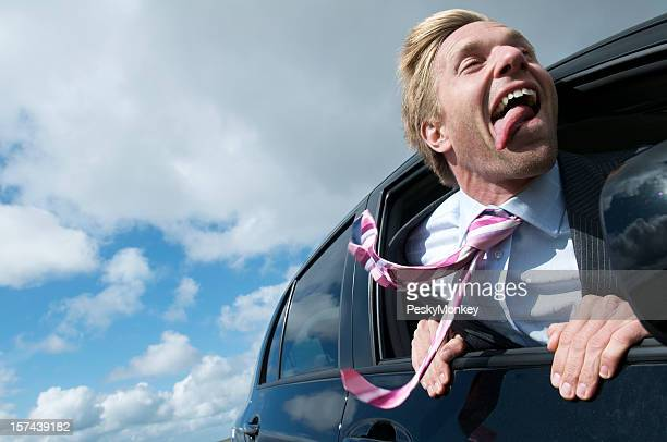 Excited Businessman Leans His Head out the Car Window