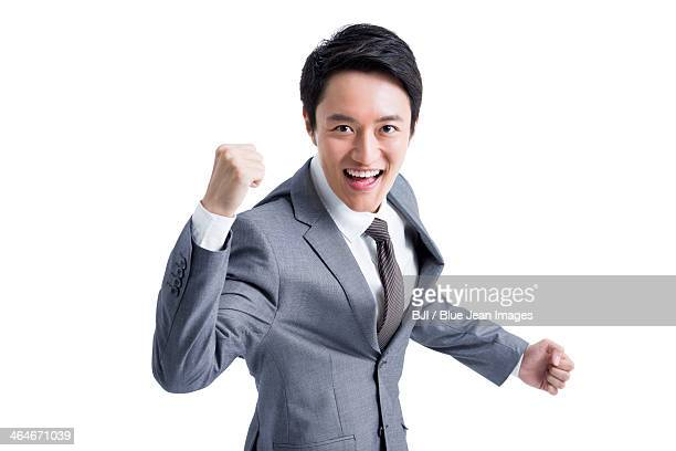 Excited businessman punching the air
