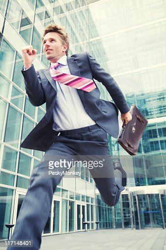 Excited Businessman Running Out of Office with Briefcase