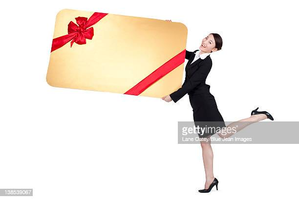 Excited Businesswoman Holding an Oversized Wrapped Card