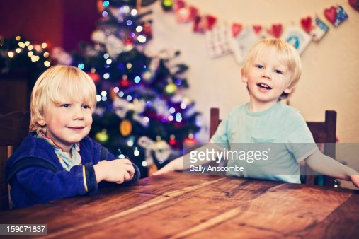 Excited children at Christmas time : Stock Photo