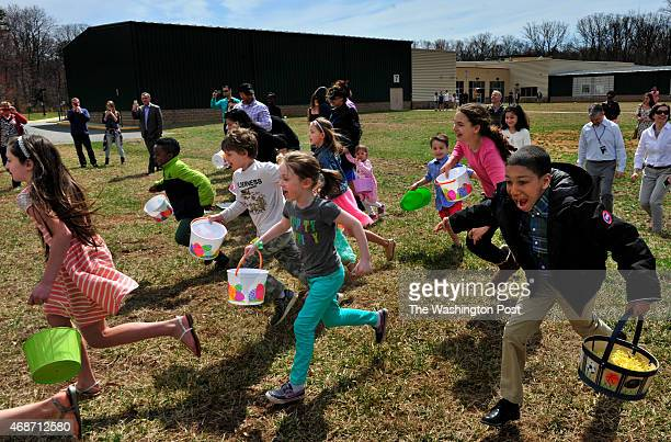 Excited children can't wait to get to a field and collect Easter eggs at the helicopter egg drop held this morning The City Church Fairfax Campus...