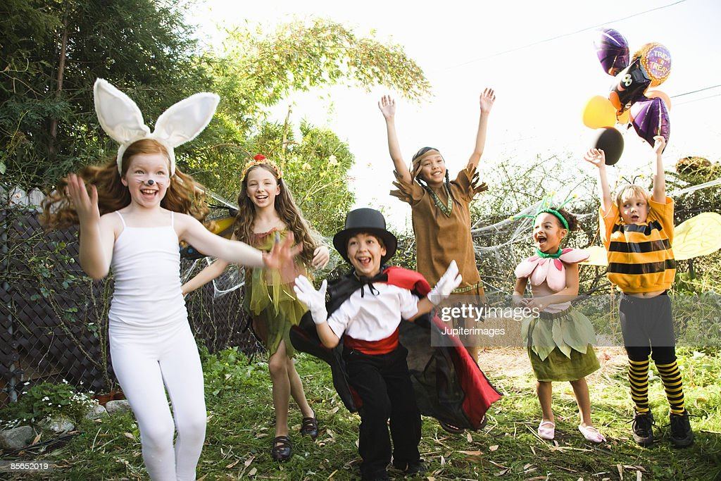 Excited children in Halloween costumes