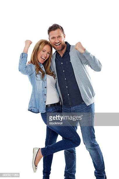 Excited couple rejoicing success