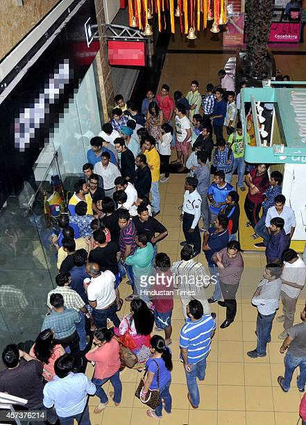 Excited crowd flocked at The Great India Palace mall to buy newly launched Apple iPhone 6 and iPhone 6 Plus on October 17 2014 in Noida India The...