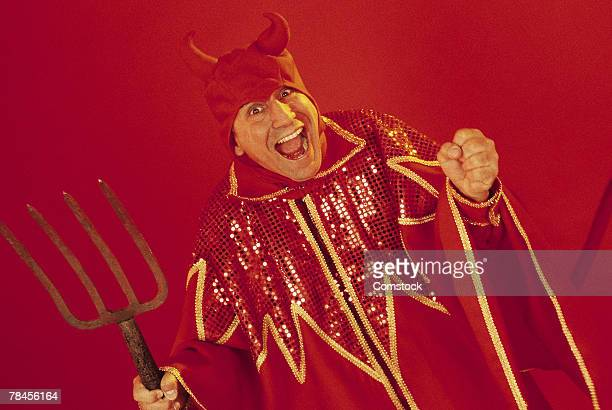 Excited devil with pitchfork