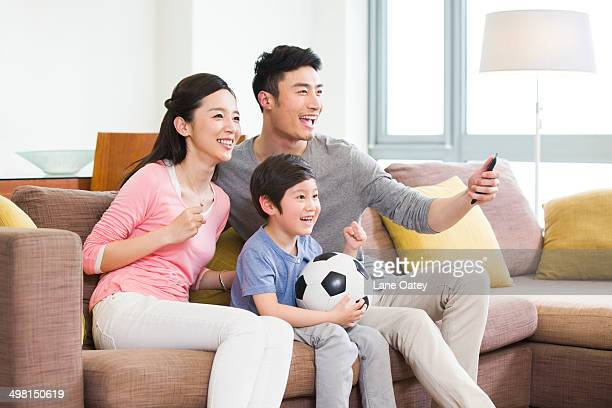 Excited family watching football on TV