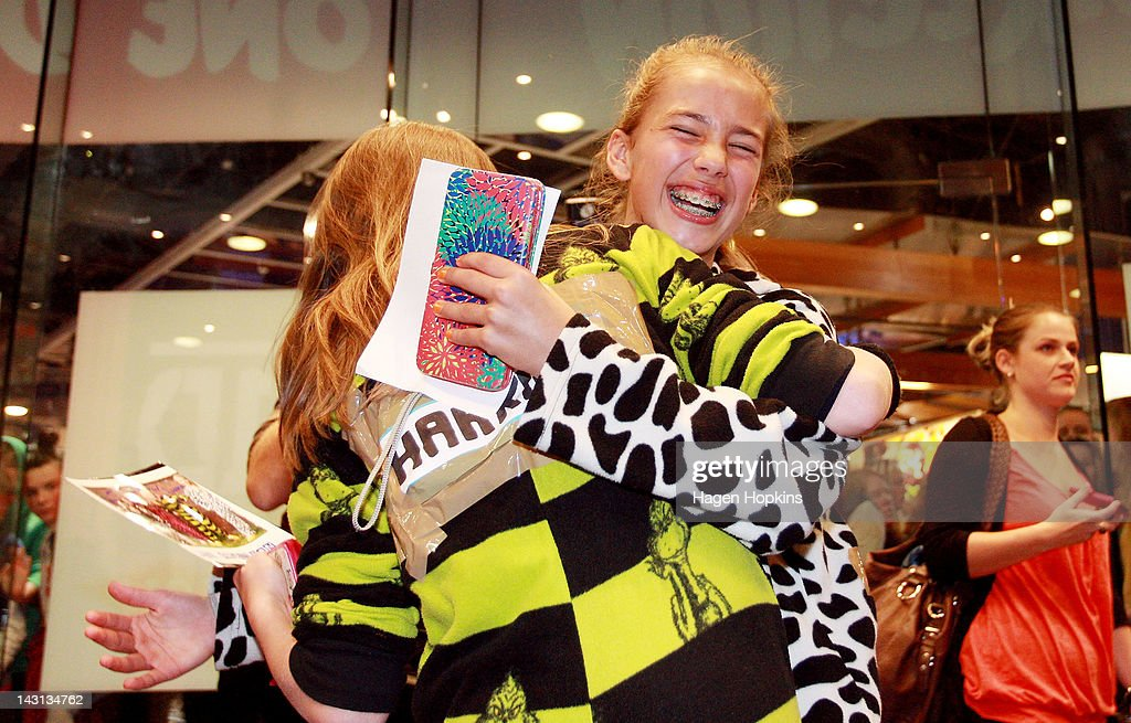 Excited fans hug each other inside the official One Direction merchandise store on April 20, 2012 in Wellington, New Zealand. The 1D fan store will sell official merchandise for four days only, closing on Monday, April 20. One Direction is on tour in New Zealand performing a show in Auckland and Wellington before returning to the UK.