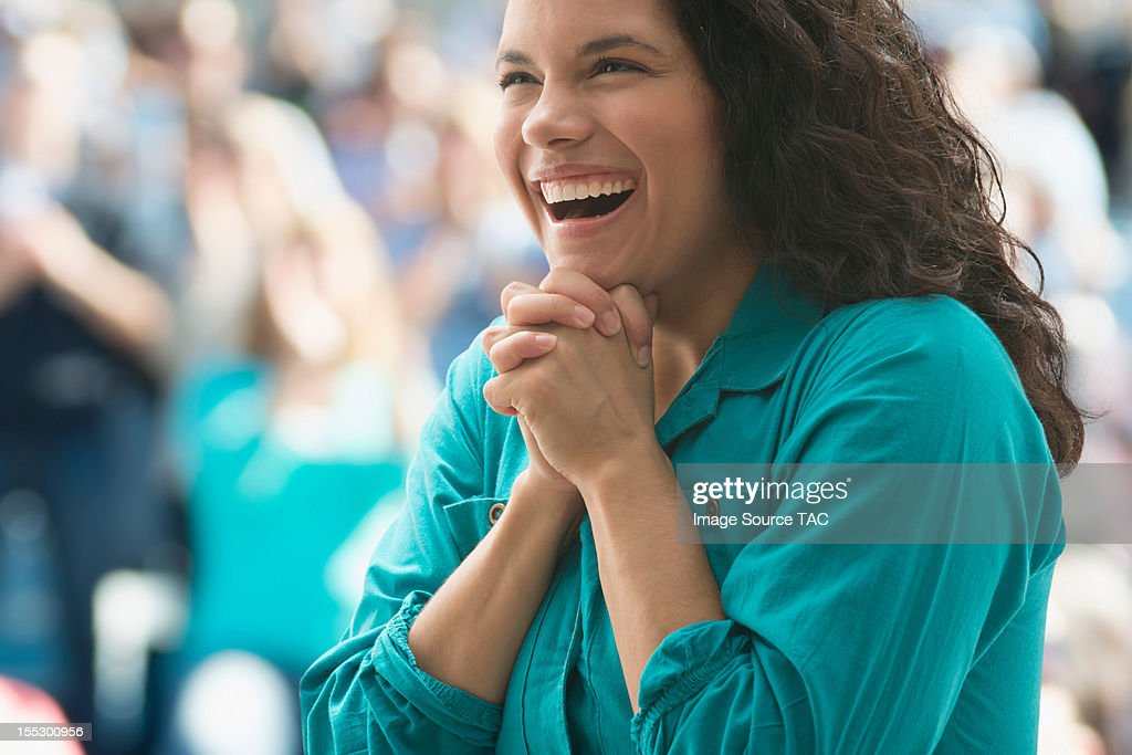 Excited female spectator : Stock Photo