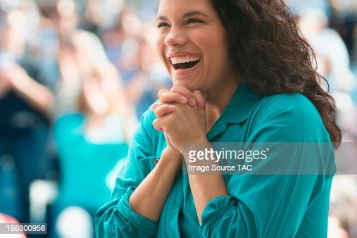 Excited female spectator : Stock Photo