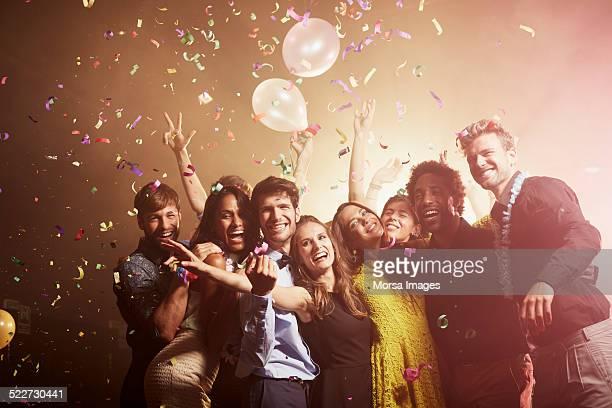 Excited friends enjoying at nightclub