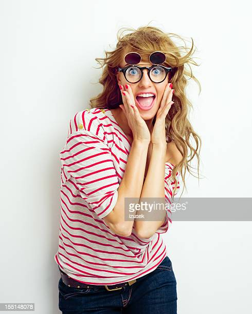 Excited girl wearing funny glasses