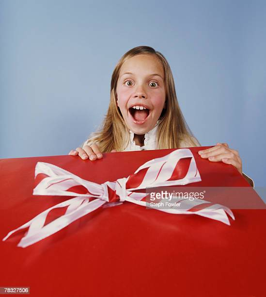Excited girl with present
