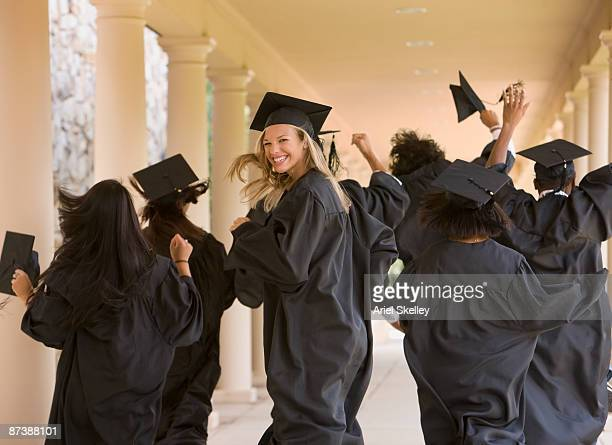 Excited graduating students in caps and gowns