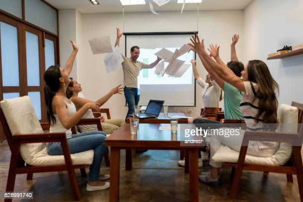 Excited group of people celebraing their success in a business meeting
