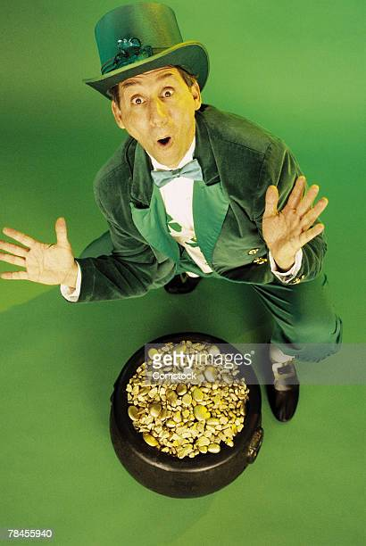 Excited leprechaun with pot of gold