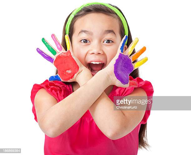 Excited Little Asian Girl With Painted Hands