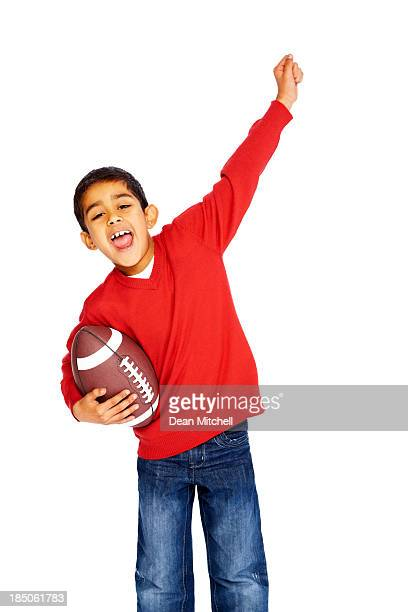 Excited little football fan isolated on white