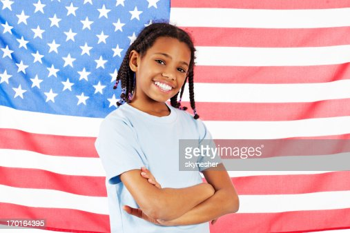 Excited little girl and American flag : Stock Photo