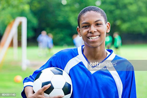 Excited male teenage soccer player