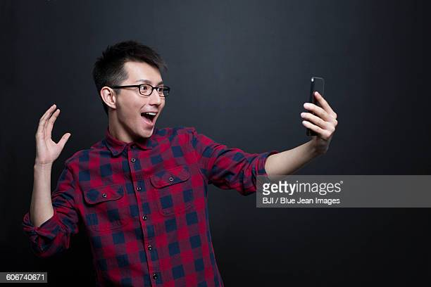Excited man holding a smart phone